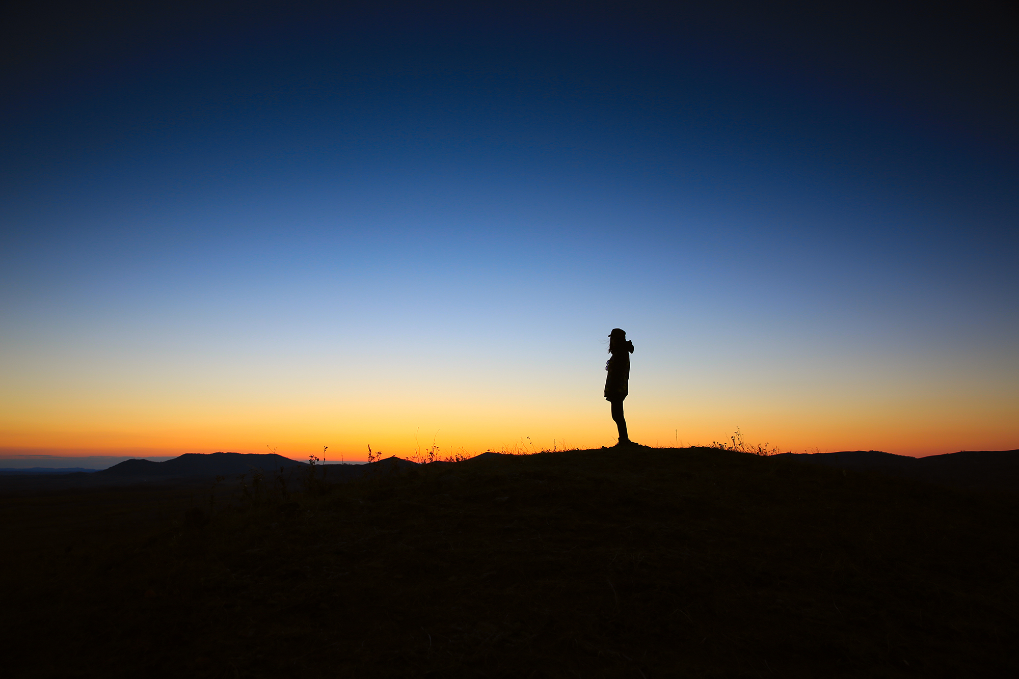Unsplash Lone Hiker at Sunset